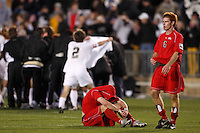 Ohio State Buckeyes midfielder Geoff Marsh (9) and defender Matt Gold (6) react to loosing as the Wake Forest Demon Deacons celebrate their victory in the background. The Wake Forest Demon Deacons defeated the Ohio State Buckeyes 2-1 in the finals of the NCAA College Cup at SAS Stadium in Cary, NC on December 16, 2007.
