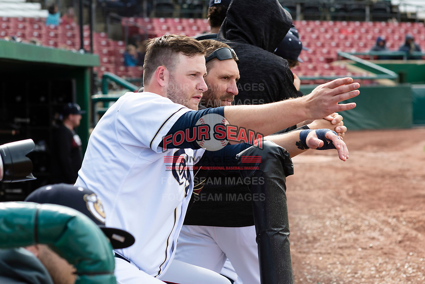 Kane County Cougars Zack Shannon (18) talks to field coordinator Joe Mather during a Midwest League game against the Cedar Rapids Kernels at Northwestern Medicine Field on April 28, 2019 in Geneva, Illinois. Kane County defeated Cedar Rapids 3-2 in game one of a doubleheader. (Zachary Lucy/Four Seam Images)