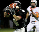 Tualatin senior wide receiver Cody Gibson makes a 24-yard touchdown catch from quarterback Levi Levasa making the score 7-7 against Beaverton in the first quarter in the quarterfinal playoff game November 21,2008..Photo by Jaime Valdez