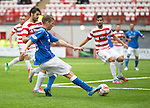 Hamilton Accies v St Johnstone...16.08.14  SPFL<br /> David Wotherspoon crosses the ball only to see defender Stephen Hendrie rattle the ball onto the cross bar in an attepmt to clear the ball.<br /> Picture by Graeme Hart.<br /> Copyright Perthshire Picture Agency<br /> Tel: 01738 623350  Mobile: 07990 594431
