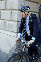 Boris Johnson leaving London Fashion Week on a bicycle