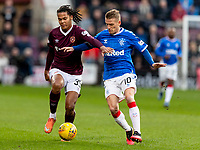 26th January 2020, Tynecastle Park, Edinburgh, Scotland; Scottish Premier League football, Hearts of Midlothian versus Rangers; Toby Sibbick of Hearts and Steven Davis of Rangers compete for the ball