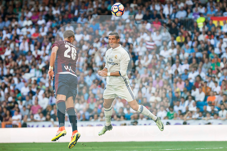Real Madrid's player Cristiano Ronaldo and Eibar FC's player Florian Lejeune during a match of La Liga Santander at Santiago Bernabeu Stadium in Madrid. October 02, Spain. 2016. (ALTERPHOTOS/BorjaB.Hojas)
