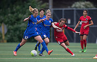 Seattle, WA - Saturday, May 14, 2016: Seattle Reign FC midfielder Beverly Yanez (17), midfielder Kim Little (8) and Portland Thorns FC midfielder Meleana Shim (6) battle for the ball during the first half. The Portland Thorns FC and the Seattle Reign FC played to a 1-1 tie during a regular season National Women's Soccer League (NWSL) match at Memorial Stadium.