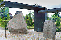 Jelling Stones runestones royal monument reign of Gorm , in glass cabinet at birthplace of Christianity in Denmark