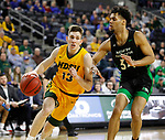 SIOUX FALLS, SD - MARCH 10: Chris Quayle #13 of the North Dakota State Bison drives on De'sean Allen-Eikens #34 of the North Dakota Fighting Hawks during the men's championship game at the 2020 Summit League Basketball Tournament in Sioux Falls, SD. (Photo by Richard Carlson/Inertia)