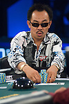 "David ""The Dragon"" Pham pushes some chips out."