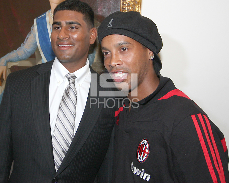 Rinku Singh of the Pittsburg Pirates poses with Ronaldinho of AC Milan at a reception for AC Milan at DAR Constitution Hall in Washington DC on May 24 2010.