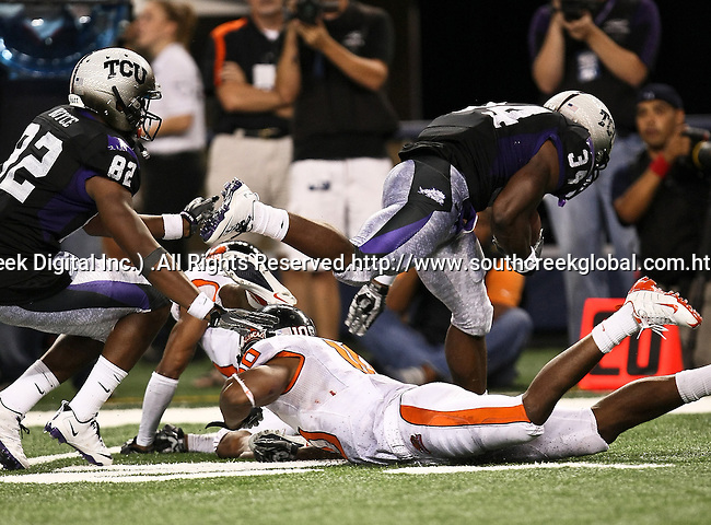 TCU Horned Frogs running back Ed Wesley #34 breaks free during the game between the Oregon State Beavers and the TCU Horned Frogs at the Cowboy Stadium in Arlington,Texas. TCU defeated Oregon State 30-21.