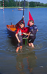 AT5CG3 Girl and boy twins with their Mirror dinghy sailing boat