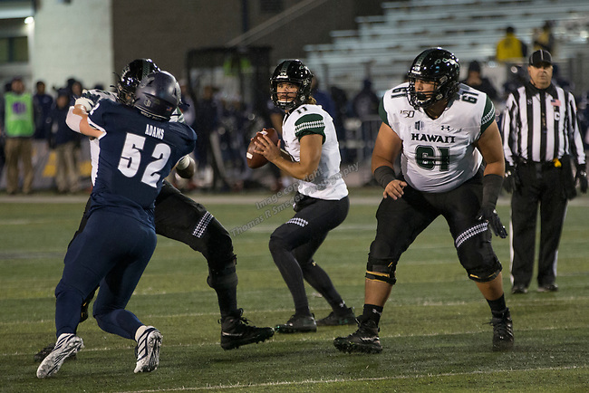 Hawaii quarterback Chevan Cordeiro (12) looks to throw against Nevada in the second half of an NCAA college football game in Reno, Nev. Saturday, Sept. 28, 2019. (AP Photo/Tom R. Smedes)
