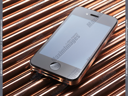 Apple iPhone 4 smartphone on shiny copper tube metal background