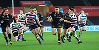 Ospreys' Rhys Webb breaks out of the tackle of Cardiff Blues' Lloyd Williams.<br /> <br /> Photographer Dan Minto/CameraSport<br /> <br /> Guinness Pro14 Round 13 - Ospreys v Cardiff Blues - Saturday 6th January 2018 - Liberty Stadium - Swansea<br /> <br /> World Copyright &copy; 2018 CameraSport. All rights reserved. 43 Linden Ave. Countesthorpe. Leicester. England. LE8 5PG - Tel: +44 (0) 116 277 4147 - admin@camerasport.com - www.camerasport.com