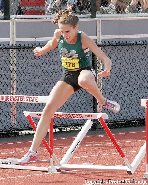 Mansfield HighÕs Jennifer Esposito runs in the 400 meter hurdle race during the 2011 All-State Outdoor Track meet on Saturday at Bridgewater State University..(Photo by Gary Wilcox).