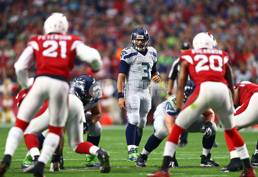 Jan 3, 2016; Glendale, AZ, USA; Seattle Seahawks quarterback Russell Wilson (3) against the Arizona Cardinals at University of Phoenix Stadium. Mandatory Credit: Mark J. Rebilas-USA TODAY Sports