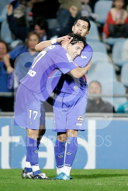 Getafe's Daniel Parejo celebrates with Juan Albin during La Liga match. October 25, 2009. (ALTERPHOTOS/Alvaro Hernandez).