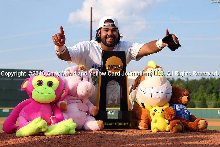 04 June 2016: Nova Southeastern's Andres Visbal poses with the championship trophy and a bunch of stuffed animals the team had won at a local amusement parlor during the tournament. The Nova Southeastern University Sharks played the Millersville University Marauders in Game 14 of the 2016 NCAA Division II College World Series  at Coleman Field at the USA Baseball National Training Complex in Cary, North Carolina. Nova Southeastern won the game 8-6 and clinched the NCAA Division II Baseball Championship.