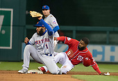 Washington Nationals center fielder Brian Goodwin (8) steals second base in the sixth inning against the Washington Nationals at Nationals Park in Washington, D.C. on Sunday, April 8, 2018.  New York Mets shortstop Amed Rosario (1) defends on the play.  The Mets won the game 6-5.<br /> Credit: Ron Sachs / CNP<br /> (RESTRICTION: NO New York or New Jersey Newspapers or newspapers within a 75 mile radius of New York City)