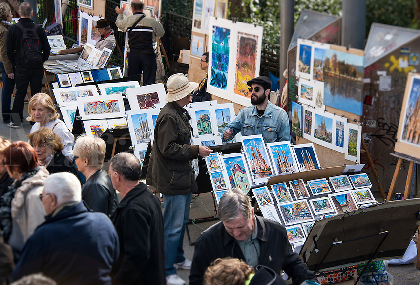 Art street vendors sell their wares outside the Basilica Sagrada Família, Barcelona, Spain