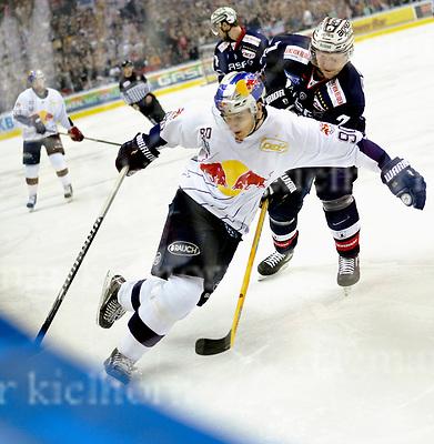 March 31-17,Mercedes-Benz-Arena,Berlin,Germany<br /> DEL Ice-Hockey ,German ice-hockey<br /> Playoff game number 4<br /> Eisbaeren Berlin vs EHC Red Bull M&Uuml;NCHEN<br /> Berlin`s defenseman Frank H&ouml;rdler stops Munich`s Jerome Flaake