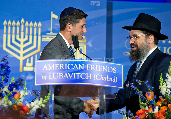 The Speaker of the United States House of Representatives Paul D. Ryan (Republican of Wisconsin), left, shakes hands with Rabbi Levi Shemtov, Executive Vice President of American Friends of Lubavitch (Chabad), right, after receiving the the 2017 Lamplighter Award from  at the Mellon Auditorium in Washington, DC on Tuesday, June 6, 2017.<br /> Credit: Ron Sachs /CNP/MediaPunch