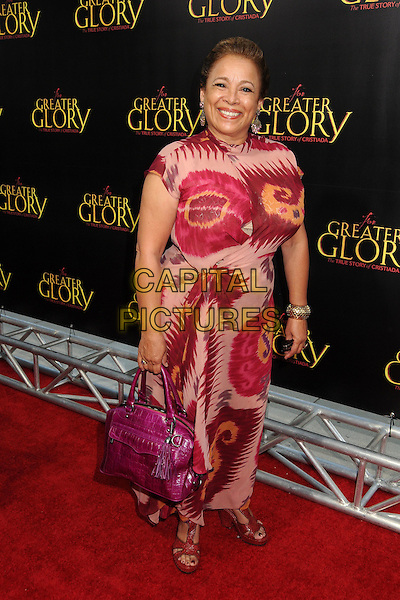 """Alma Martinez.""""For Greater Glory"""" Los Angeles Premiere held at the AMPAS Samuel Goldwyn Theater, Beverly Hills, California, USA..May 31st, 2012.full length pink red print dress bag purse.CAP/ADM/BP.©Byron Purvis/AdMedia/Capital Pictures."""
