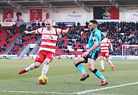 Luke McCullough of Doncaster Rovers wins the ball against Lewis Coyle of Fleetwood Town during the Sky Bet League 1 match between Doncaster Rovers and Fleetwood Town at the Keepmoat Stadium, Doncaster, England on 17 February 2018. Photo by Leila Coker / PRiME Media Images.