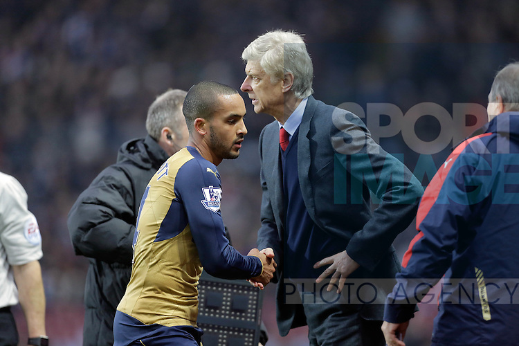 Arsenal manager Arsene Wenger with Theo Walcott  - Football - Barclays Premier League - Aston Villa vs Arsenal - Villa Park Birmingham - 13th December 2015 - Season 2015/2016 - Photo Malcolm Couzens/Sportimage