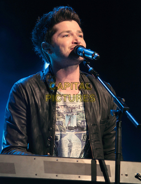 The Script - Danny O'Donoghue .performing live in concert at the Mann Music Center in Philadelphia, Pennsylvania, USA, June 3rd, 2011..music on stage gig half length microphone singing black leather jacket playing keyboard  .CAP/RKE/EML.©EML/RockinExposures/Capital Pictures.