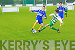 Listowel Celtics Cillian Langan tackles Jonathon Kissane of Killorglin last Saturday in Pat Kennedy Park.