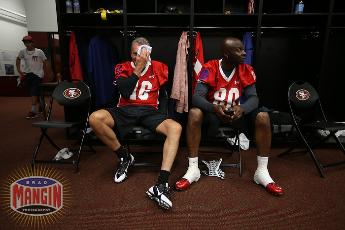 SAN FRANCISCO, CA - JULY 12:  Former San Francisco 49ers greats Joe Montana and Jerry Rice talk in the locker room before the Legends of Candlestick flag football game at Candlestick Park in San Francisco, California on July 12, 2014. Photo by Brad Mangin