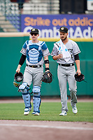 Charlotte Knights catcher Zack Collins (8) and pitcher Justin Nicolino (30) walk to the dugout from the bullpen before an International League game against the Rochester Red Wings on June 16, 2019 at Frontier Field in Rochester, New York.  Rochester defeated Charlotte 3-2 in the second game of a doubleheader.  (Mike Janes/Four Seam Images)