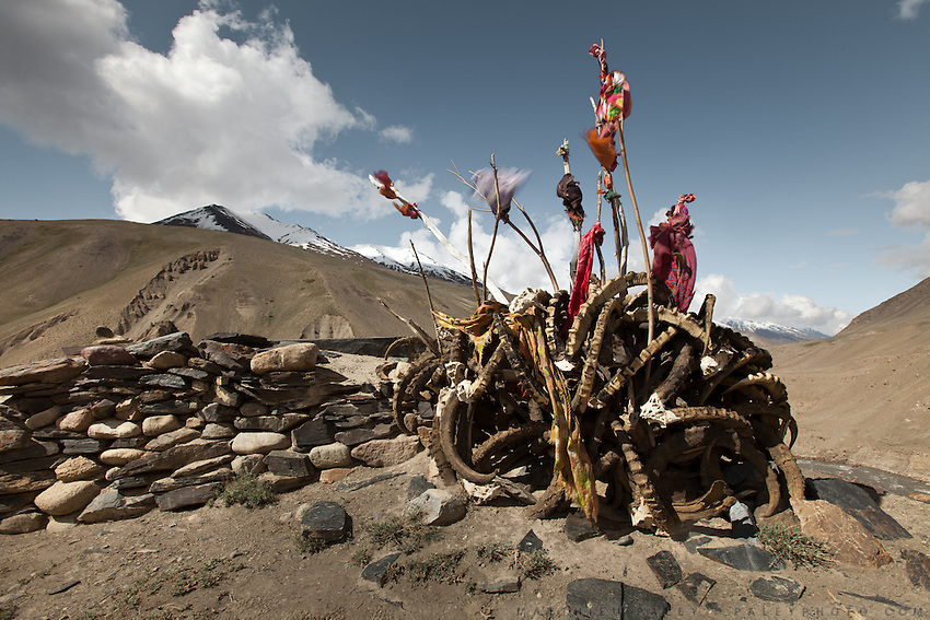 An Ismaili Muslim shrine full of ibex horn. Trekking up and along the Wakhan river, the only way to reach the high altitude Little Pamir plateau, home of the Afghan Kyrgyz community.