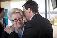 PQ MNAs Agnes Maltais and Pierre-Karl Peladeau chat during the presentation of parti Quebecois candidates for the upcoming byelection Tuesday May 5, 2015.
