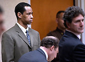Sniper suspect John Allen Muhammad, left, listens as his newly reappointed attorneys Peter Greenspun, center and Jonathan Shapiro, right, watch court proceedings during his trial in courtroom 10 at the Virginia Beach Circuit Court in Virginia Beach, Virginia, Wednesday October 22, 2003. Muhammad decided to allow his attorneys to represent him in court. <br /> Credit: Davis Turner - Pool via CNP
