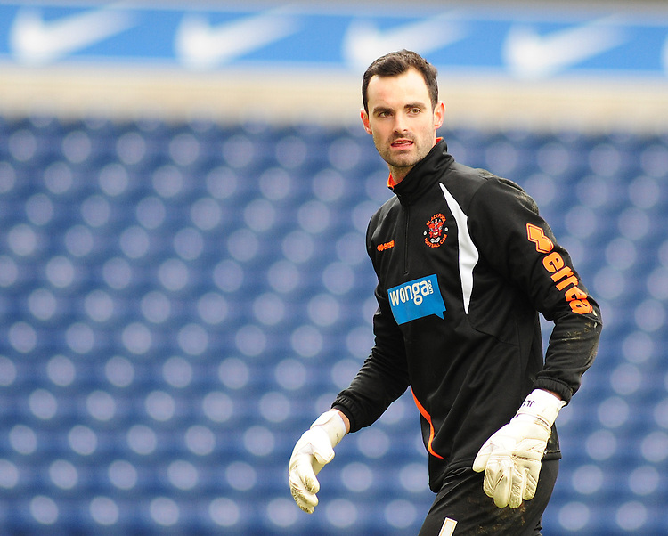 Blackpool's Joe Lewis during the pre-match warm-up <br /> <br /> Photographer Andrew Vaughan/CameraSport<br /> <br /> Football - The Football League Sky Bet Championship - Blackburn Rovers v Blackpool - Saturday 21st February 2015 - Ewood Park - Blackburn<br /> <br /> &copy; CameraSport - 43 Linden Ave. Countesthorpe. Leicester. England. LE8 5PG - Tel: +44 (0) 116 277 4147 - admin@camerasport.com - www.camerasport.com