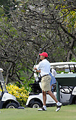 Kailua, Hawaii - December 29, 2008 -- United States President-elect Barack Obama watches his shot on the tenth tee as he plays golf with friends in Kailua, Hawaii on Monday, December 29, 2008. Obama and his family arrived in his native Hawaii December 20 for the Christmas holiday..Credit: Joaquin Siopack - Pool via CNP