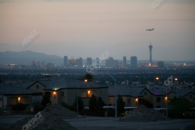 New housing developments in Henderson suburb with the skyline of Las Vegas in the distance, Nevada, USA, April 8, 2008.