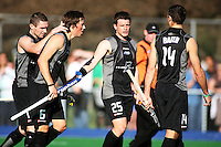 NZ captain Phil Burrows (left) congratulates Simon Childs for scoring the first goal during the international hockey match between the New Zealand Black Sticks and Malaysia at Fitzherbert Park, Palmerston North, New Zealand on Sunday, 9 August 2009. Photo: Dave Lintott / lintottphoto.co.nz