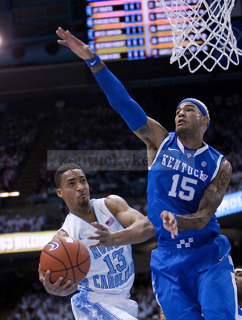 Kentucky Wildcats forward Willie Cauley-Stein (15) guards North Carolina Tar Heels forward J.P. Tokoto (13) during the UK men's basketball vs. North Carolina at the Dean Smith Center in Chapel Hill, N.C., on Saturday, December 14, 2013. Photo by Emily Wuetcher | Staff
