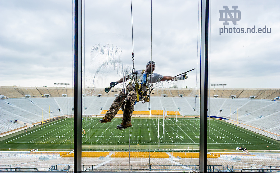 Aug. 22, 2013; Window washing in the ND Stadium press box.<br />