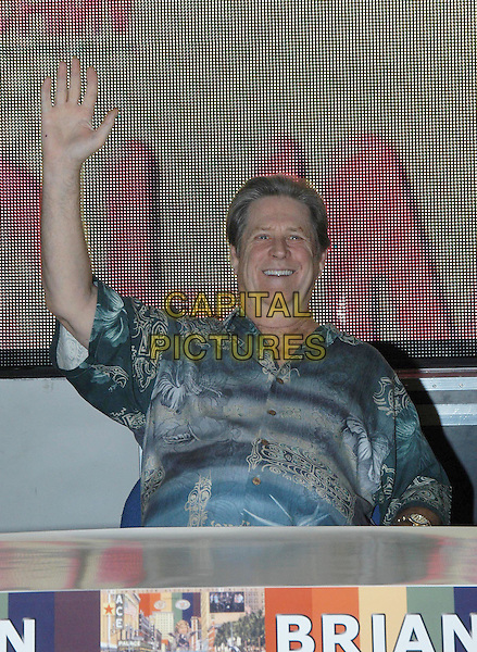 BRIAN WILSON.HMV, 150 Oxford Street, signing copies of his new album 'Gettin' In Over My Head'.29th July, 2004  .half length, waving, gesture, double chin.www.capitalpictures.com.sales@capitalpictures.com.©Capital Pictures