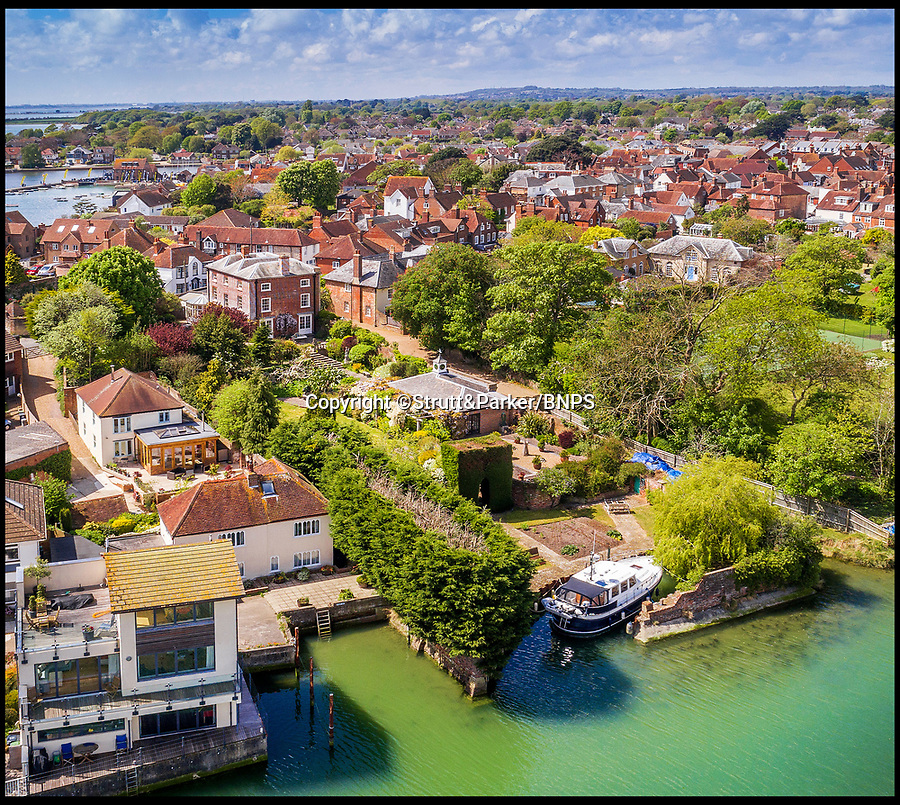 BNPS.co.uk (01202 558833)<br /> Pic: Strutt&Parker/BNPS<br /> <br /> Hello Sailor? - The perfect seaside residence for a lover of the sea.<br /> <br /> A luxury harbourside home with its own private dock in the back garden has launched on to the market - but you'll need a pirates treasure to afford it.<br /> <br /> £3.4million Wharf House is located in one of the country's best sailing communities in Emsworth, Hants, and is surrounded by water.<br /> <br /> From the front it has spectacular views over Chichester Harbour and at the back there is a mooring space for a large boat.