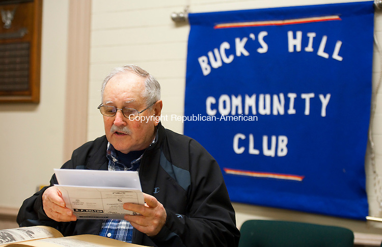 WATERBURY,  CT-111716JS11- Mel Cooney president of the Bucks Hill Community Center, goes over papers as he an other members talk about the history, and future, of the Bucks Hill Community Center at the center on Bucks Hill Road in Waterbury. <br /> Jim Shannon Republican American