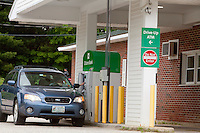 A man uses a Citizens Bank ATM drive through in Conway, New Hampshire Thursday June 13, 2013. A wholly owned subsidiary of the Royal Bank of Scotland Group, Citizens Financial Group, Inc. is an American bank.