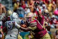 TALLAHASSEE, FLA 9/10/16-Florida State's Derrick Kelly, center, blocks Charleston Southern's Nick Sands during second quarter action Saturday at Doak Campbell Stadium in Tallahassee. <br /> COLIN HACKLEY PHOTO