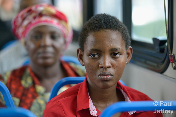 Gradise Nishimwe, a resettled refugee from Rwanda, rides a public bus in Durham, North Carolina. Behind her is her mother, Evanis Gatunzi. The family was resettled in Durham by Church World Service, which resettles refugees in North Carolina and throughout the United States.<br /> <br /> <br /> Photo by Paul Jeffrey for Church World Service.