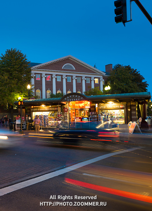 Harvard Square at night with light streaks and cars, Boston