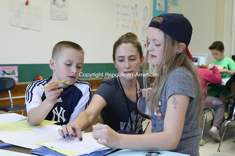 HARWINTON, CT, 01 April, 2016 - 040116LW02 - Sarah Urso, center teaches Spanish to fourth graders Kai Denton, left, and Ava Maston, right, at Harwinton Consolidated School Friday. The students were working on a project about the sports they play.<br /> Laraine Weschler Republican-American
