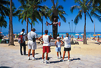 The statue of Hawaiian surfing legend Duke Kahanamoku stands in tribute along Kalakaua Ave. next to Waikiki Beach.